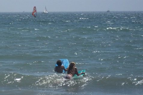 My brother and sister boogie-boarding in Long Beach circa 2011